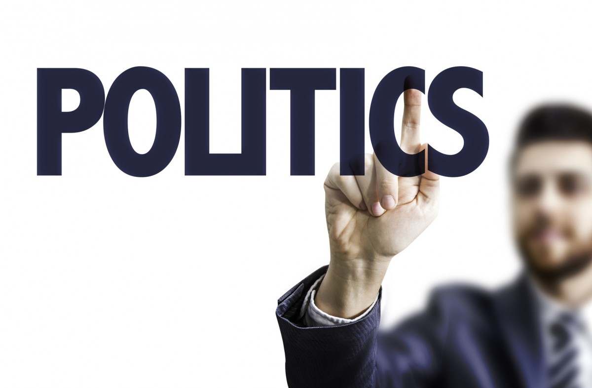 Business man pointing the text: Politics