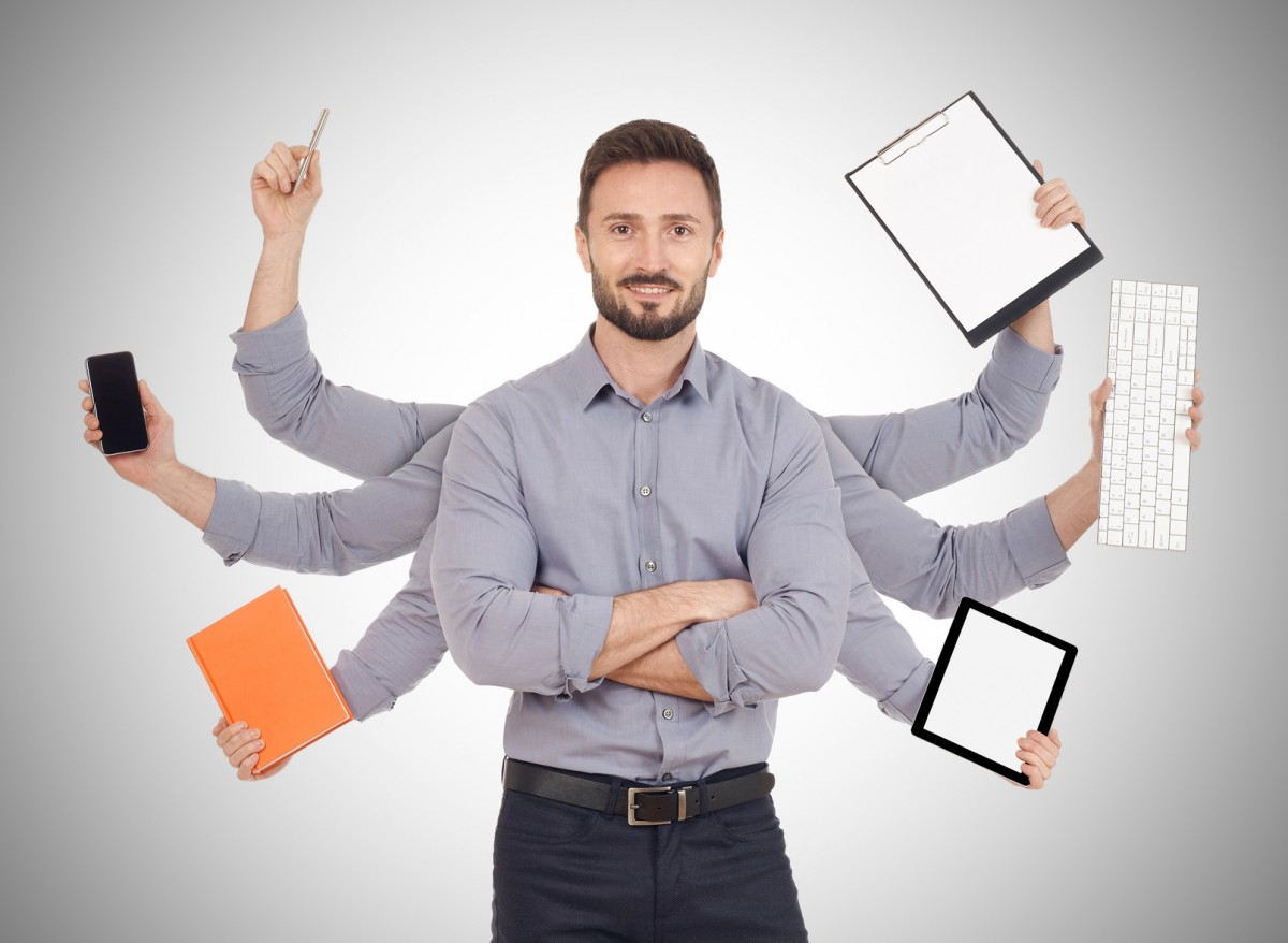 Cheerful man with office supplies in six hands, white background