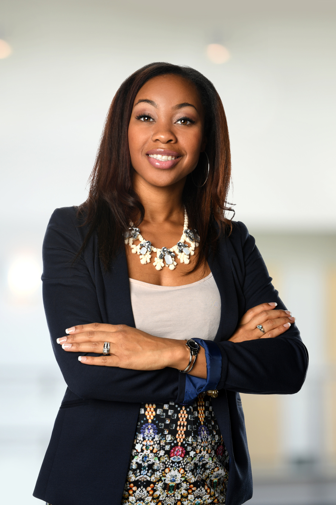 Beautiful African American woman with arms crossed inside office building