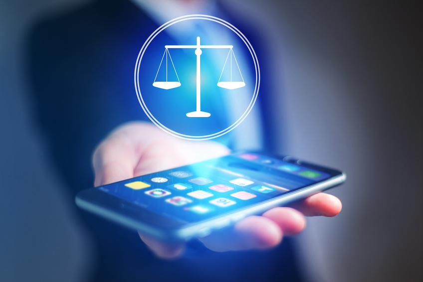 View of a Businessman hand holding mobile phone with justice icon
